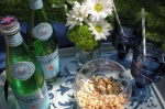Bottles of Pellegrino and salted cashews