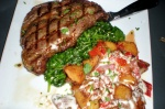 "Grilled ""Natural Angus"" Rib Eye Steak with Spinach and Sababa Potatoes"