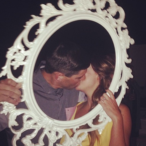 Christina and Tyler are stealing kisses in the Photo Booth (via: Facebook)
